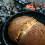 Iron-bell-baked-bread-at-Konavoski-Dvori